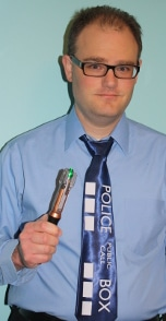 Cory Milles with his TARDIS tie and sonic screwdriver.