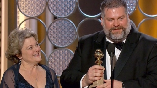 Dean DeBlois at the Golden Globes podium with producer Bonnie Arnold.