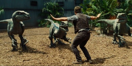 Just another day of risking his life training velociraptors.