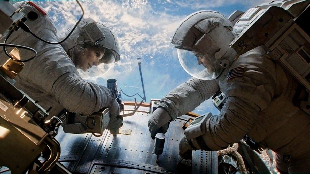 Sandra Bullock as Ryan and George Clooney as Matt in Gravity