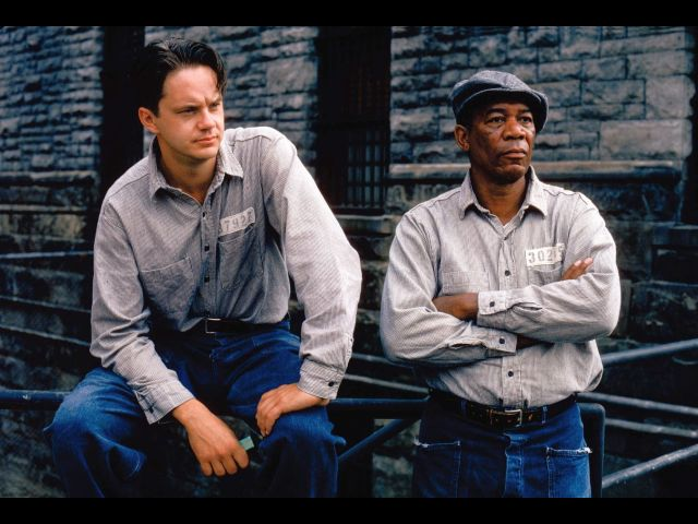 "Tim Robbins as Andy and Morgan Freeman as ""Red"" discover ""Hope is a dangerous thing."""