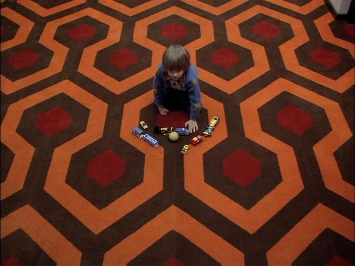 A yellow tennis ball rolling from the direction of Room 237 peaks Danny's curiosity, and so he crosses into the Midpoint.