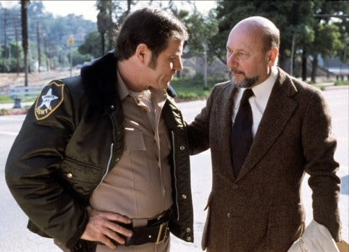 Dr. Loomis meets the local authority, Brackett, to talk the apprehension of evil.