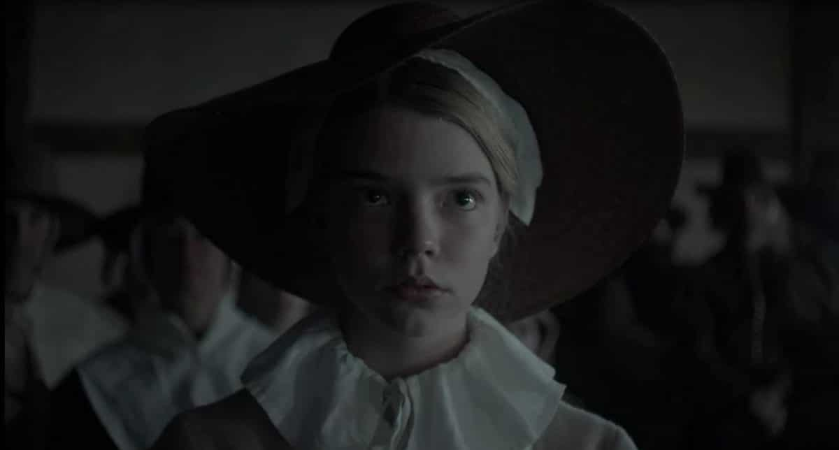 Thomasin awaits in silence as her father makes his case against his fellow settlers.