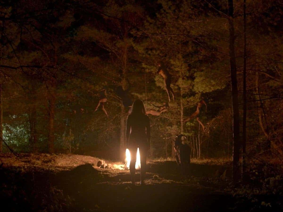 Thomasin, guided by Black Philip, joins a coven of witches in the dark wood.