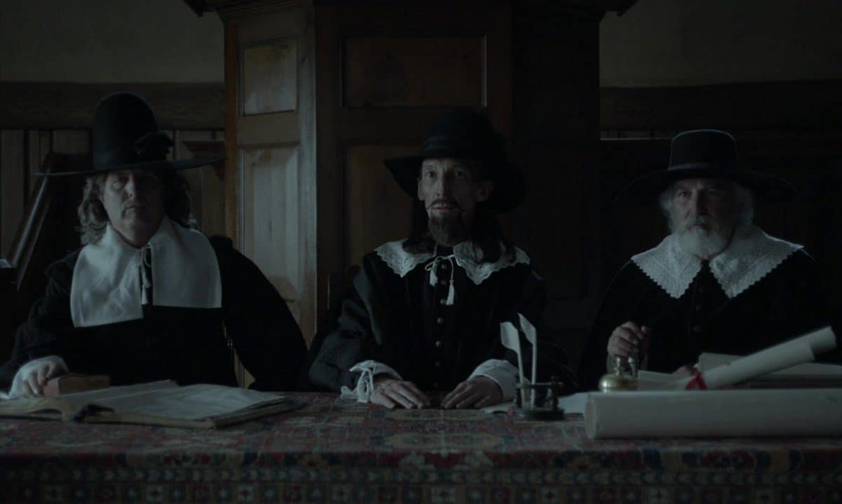 The immovable council of puritans that pass judgement on Thomasin's family.