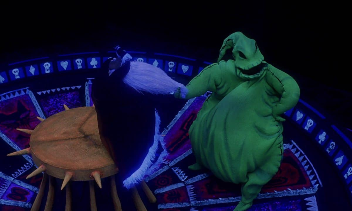 "Oogie Boogie ""entertains"" Santa in his underground, demented way with a Cab Calloway-esque jazz number."