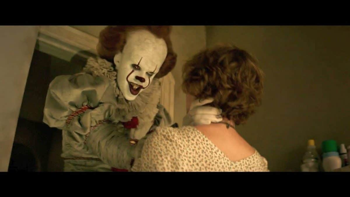 Never one for bathroom etiquette, Pennywise grabs Beverly.