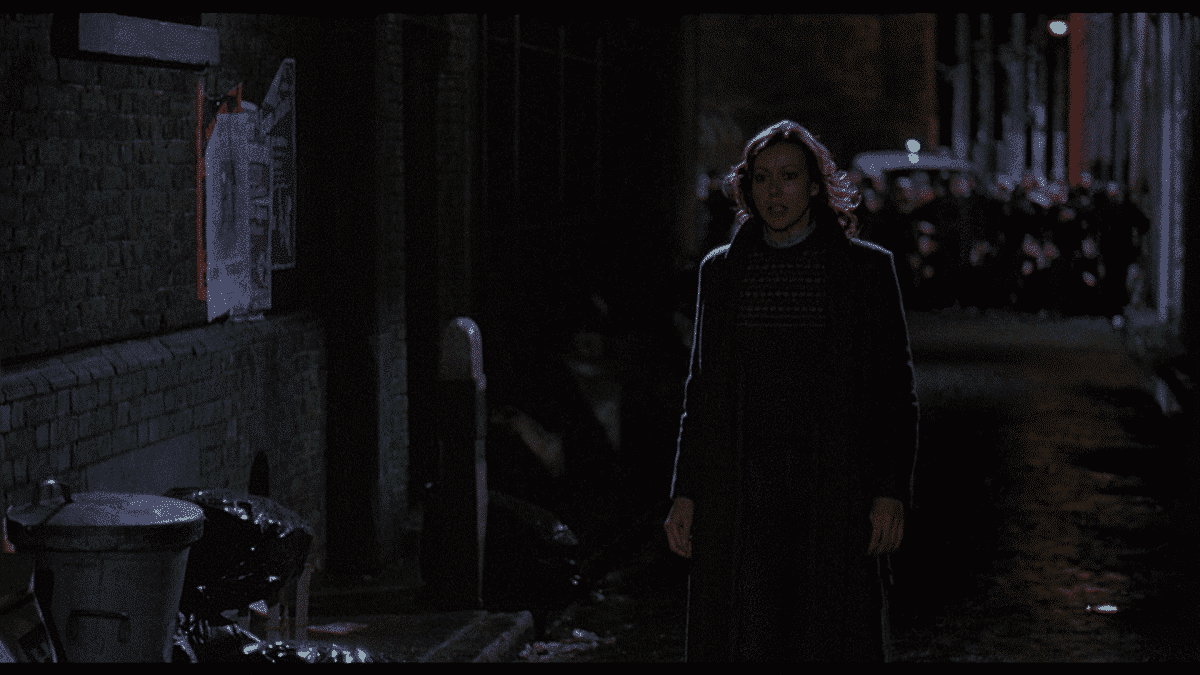 Alex courageously confronts the beast known as David in a dead-end alley.