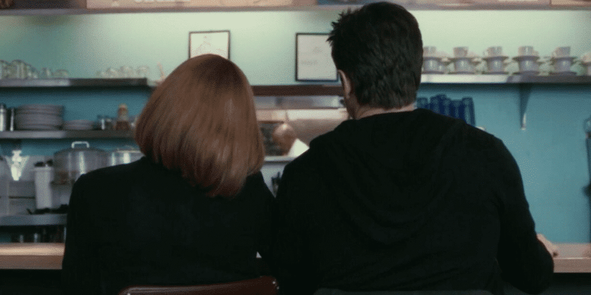 In the Final Image, Mulder and Scully hold hands instead of their phones, surrounded by humans instead of technology.
