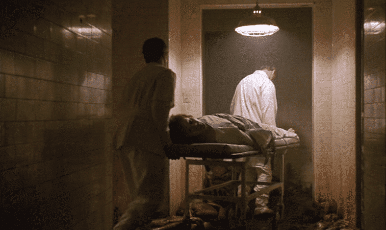 Orderlies cart Jake into the bowels of the nightmarish hospital.