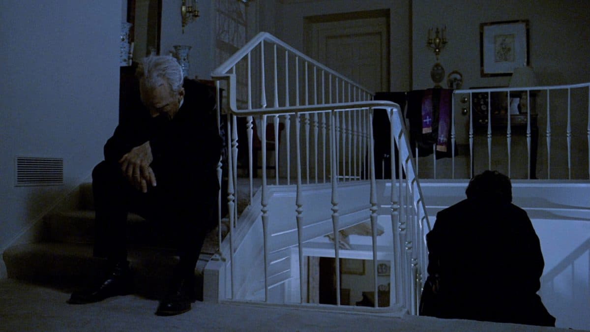 Father Merrin and Father Karras take a break as trying to expel an evil spirit is draining theirs at the same time.