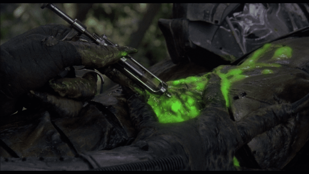 """""""If it bleeds we can kill it."""" The Predator takes care of itself before the Bad Guy Will Inevitably Close In."""