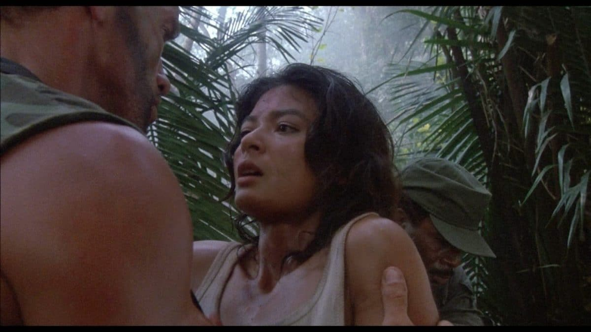 Dutch interrogates Anna again about what they're dealing with out in the jungle.