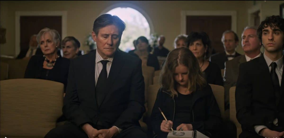 Steve, Charlie, and Peter have a family moment during the funeral.