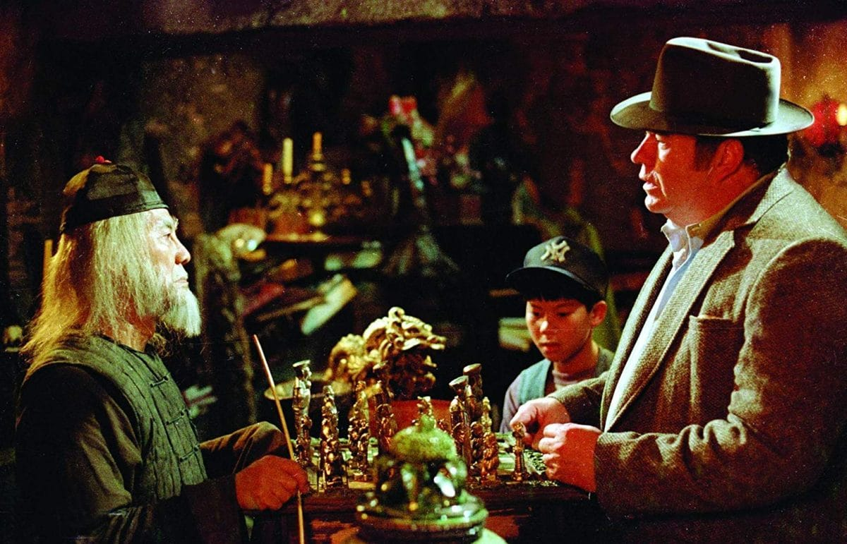 Rand Pelzer tries to bargain with Mr. Wing in the Chinatown curio shop.