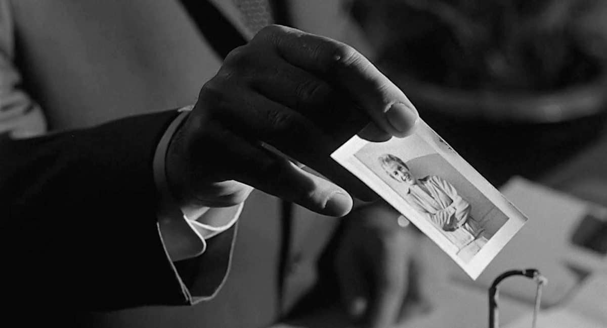 Arbogast produces a picture of Marion Crane for Norman to verify.