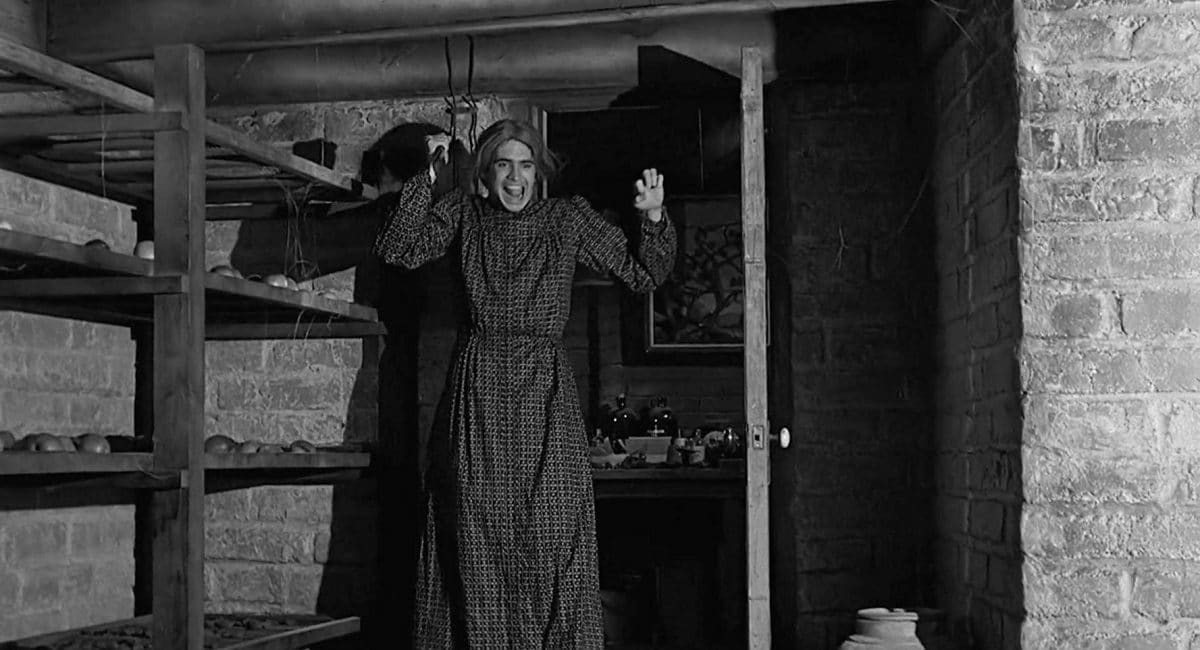 "Norman ""Norma"" Bates enters the fruit cellar to murder another nosy guest."