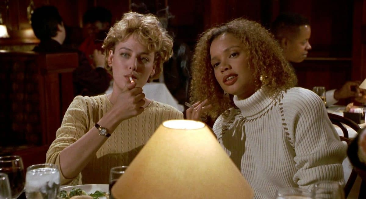 Helen and Bernadette at a stuffy academic dinner, ironically, a group they hope to one day be included.