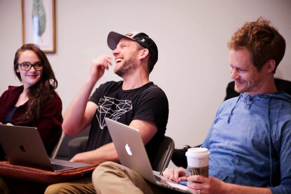 Actors Stevie Lynn Jones, David Abed, and Brian Norris share a laugh.