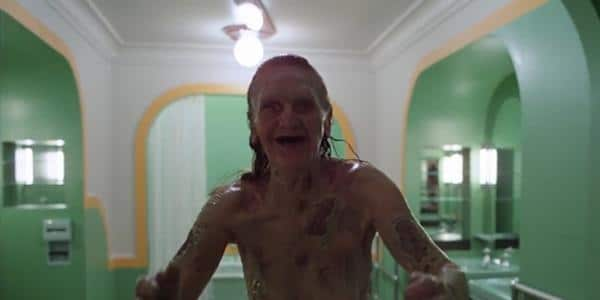 The cackling, rotting corpse dwelling within the bathtub of Room 237 awaits visitors.